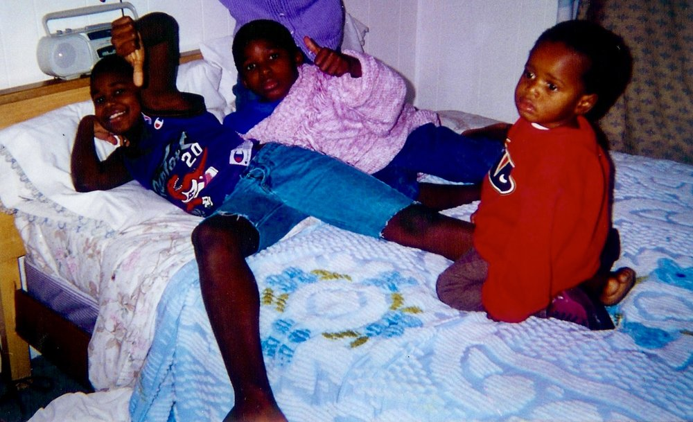 Deo and his brothers the first few days in New Hampshire after resettlement from a Refugee camp in Benin.
