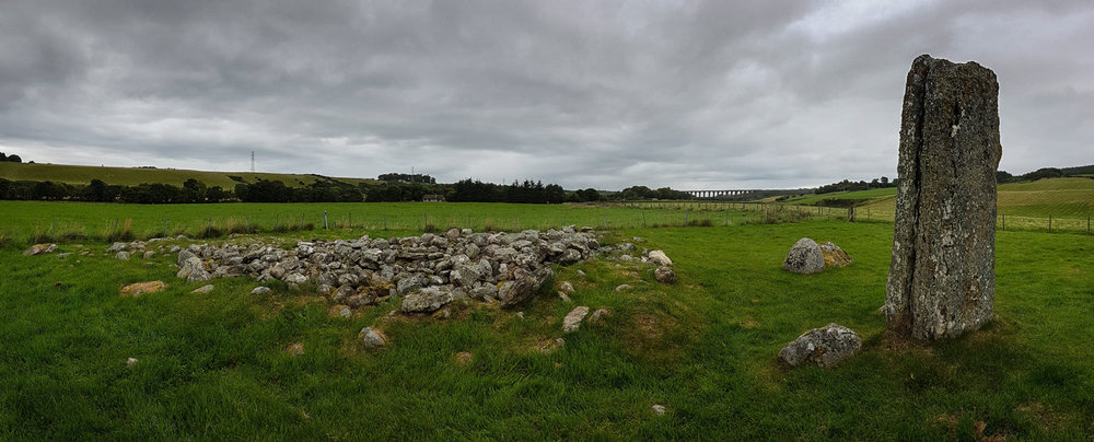 Cairn ruins and the last stone standing - click to enlarge
