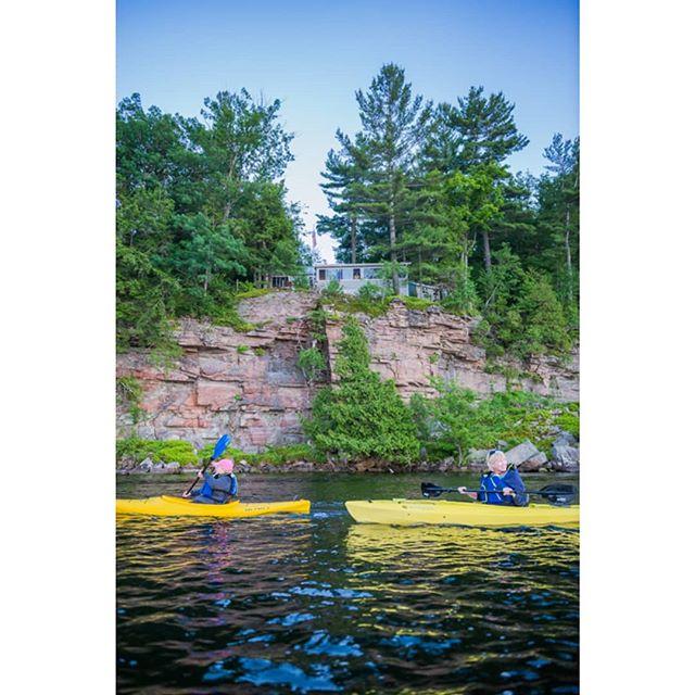 @indianriverlakes and @tilandtrust hosted a sunset paddle the other night. . . . Lake folk look on as paddlers enjoy the view. . . . . . . . #kayak #paddle #kayaking #paddleboarding #canoe #canoeing #lake #sunset #strawberry #strawberrymoon #summer #summersolstice #indianriver #thousandislands #ti #1000islands #adk #adirondacks  #adirondack #explore #exploremore #exploretocreate #getoutside