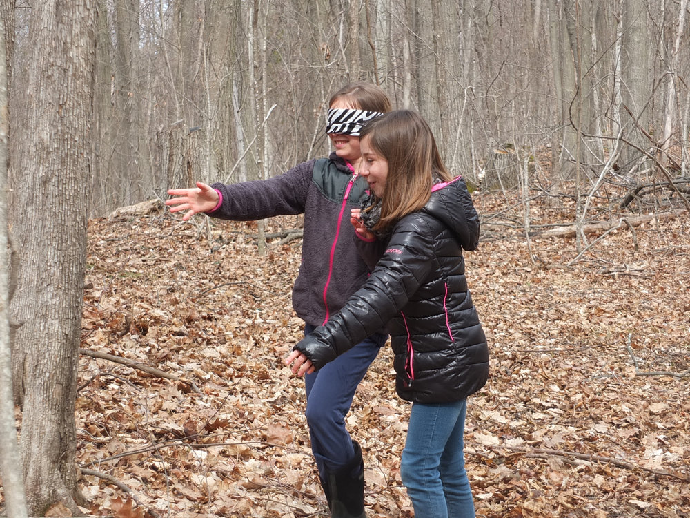 """Two girls have fun and learn to """"see"""" trees in a new way on Fox Hill at Crescent Bay Farm."""