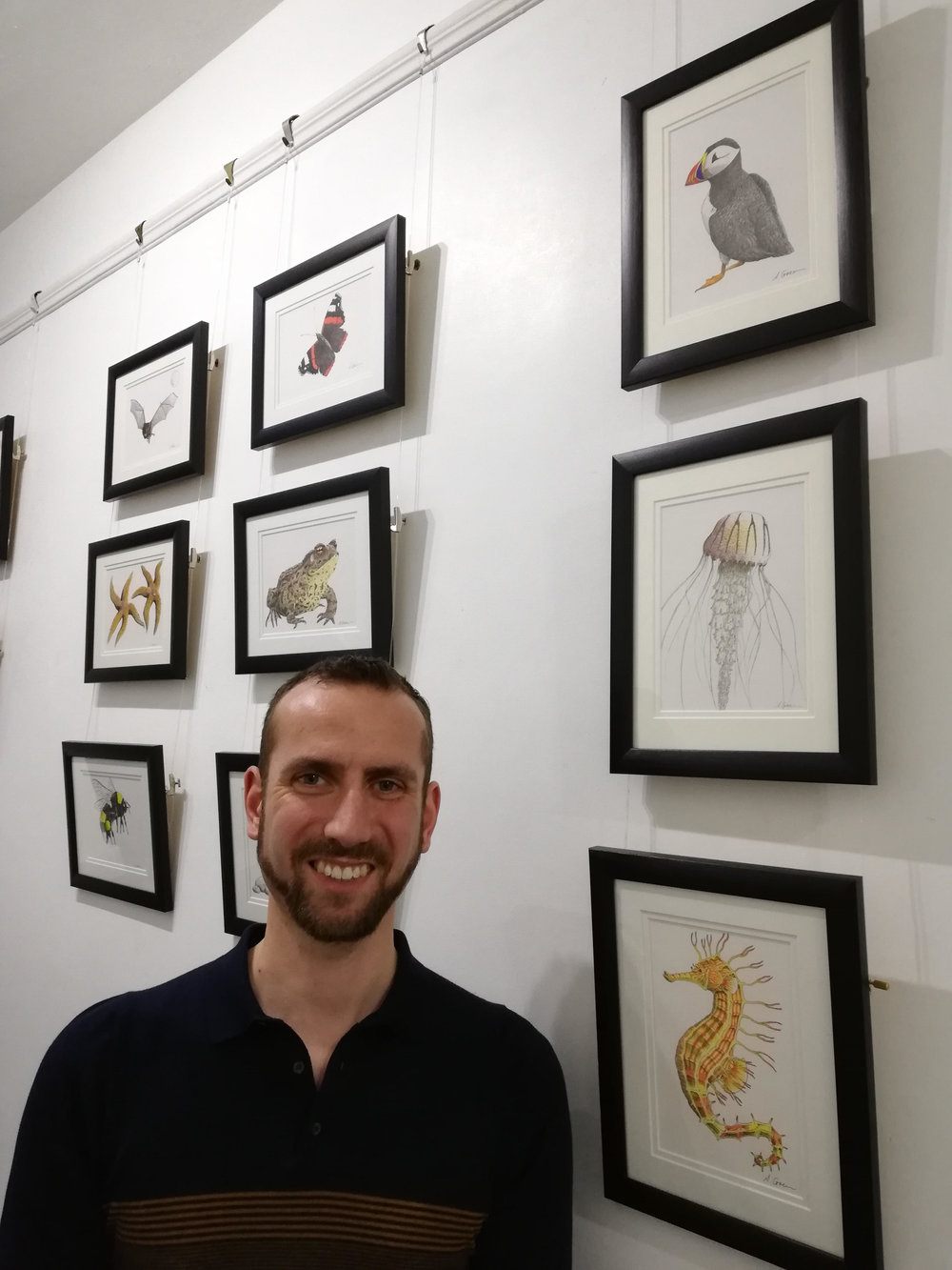 Andrew Grieveson in front of his Artwork in our Geddes Gallery.