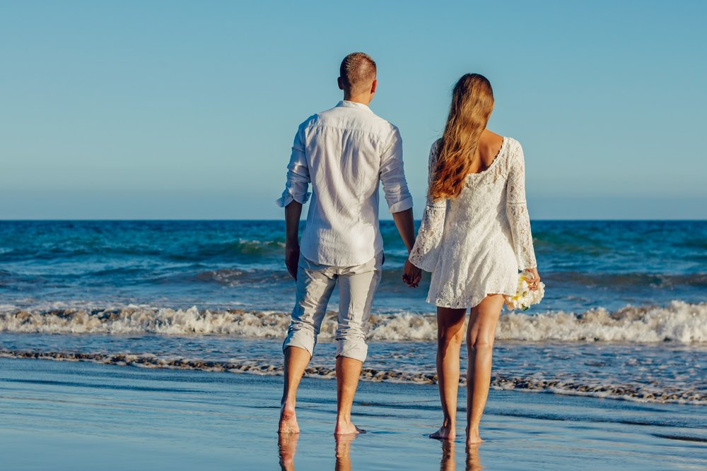 Relationships - couple holding hands on beach.jpg