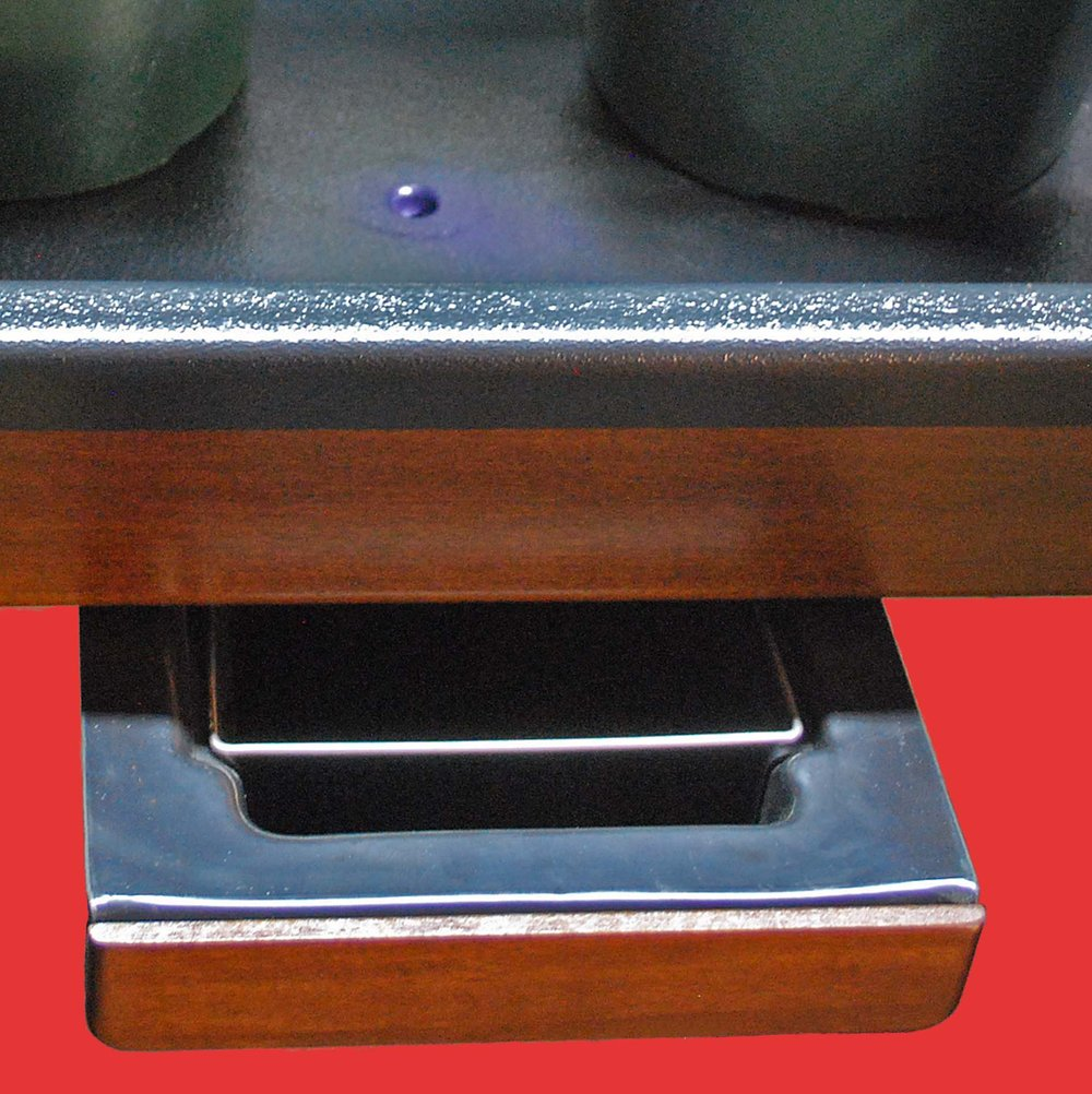 Center drain empties into removable water collection drawer