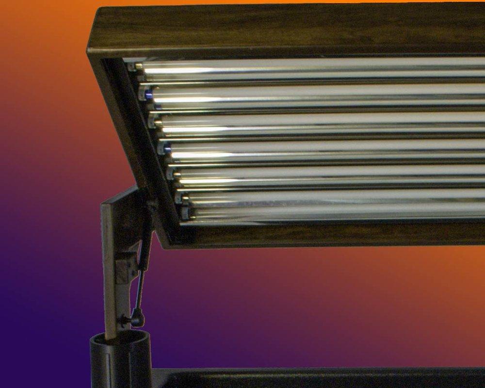 tilt the light hood for easy plant care