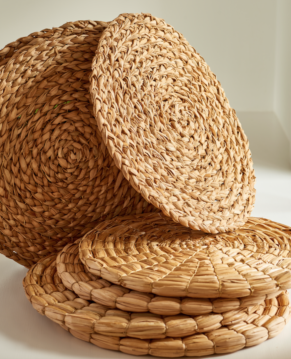Round natural seagrass mats, braided or natural, $20 each