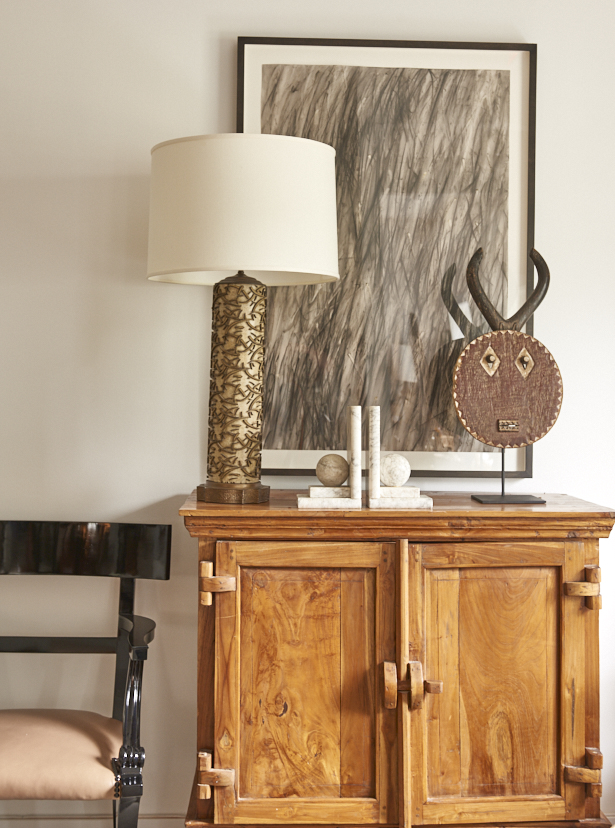 Rustic Chinese cabinet, $1800, vintage wallpaper roller lamp c. 1940, $1600, African mask, $1200, Charcoal drawing, $2200, black lacquer Klismos chair, c. 1950, $2200