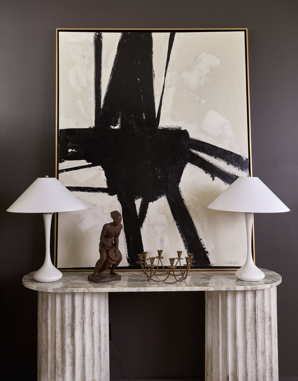 Black & white painting, price upon request, 1924 Laurel lamps c. 1980,  $1800, marble and wood column console, $2800