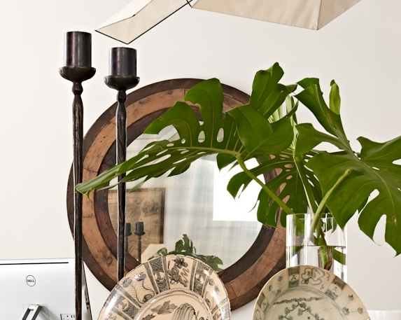 Round wood mirror with antique glass, $2400