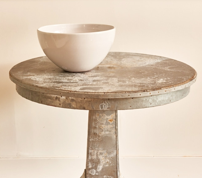 "Large white ceramic bowl, $190, vintage 36"" round zinc table, $2400"