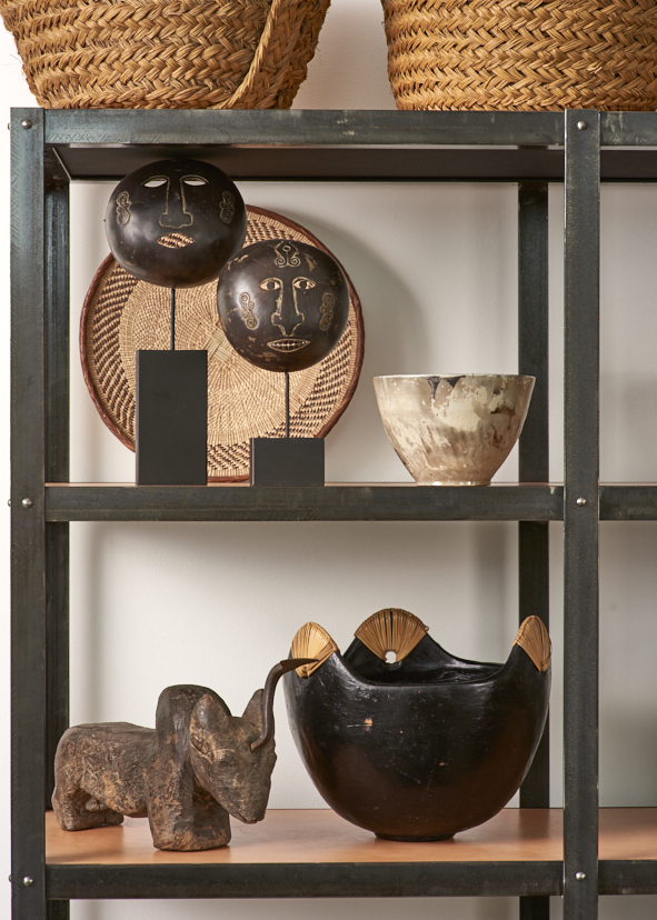 Indonesian coconut reamer $400, coconut heads, Indonesia $150, Lombok deep bowl with rattan, $250, Raku bowl $150, Tonga basket $48, Vintage Spanish baskets $120