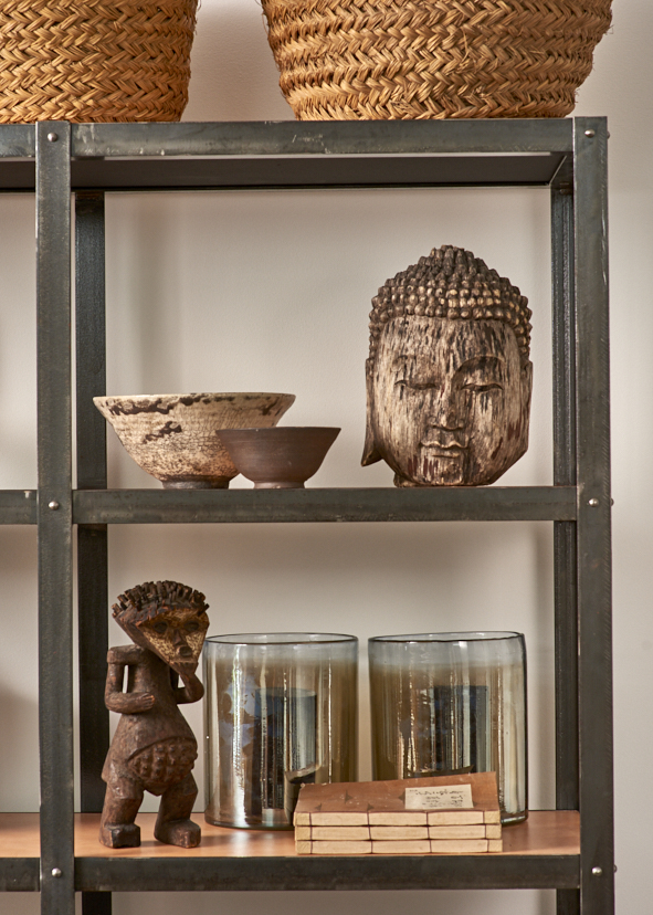 Carved wooden Buddha head, Thailand $350, Carved prosperity figure, Namibia tribe, Cameroon $1200, pair of hand blown glass hurricanes $150, Vintage Spanish baskets $120