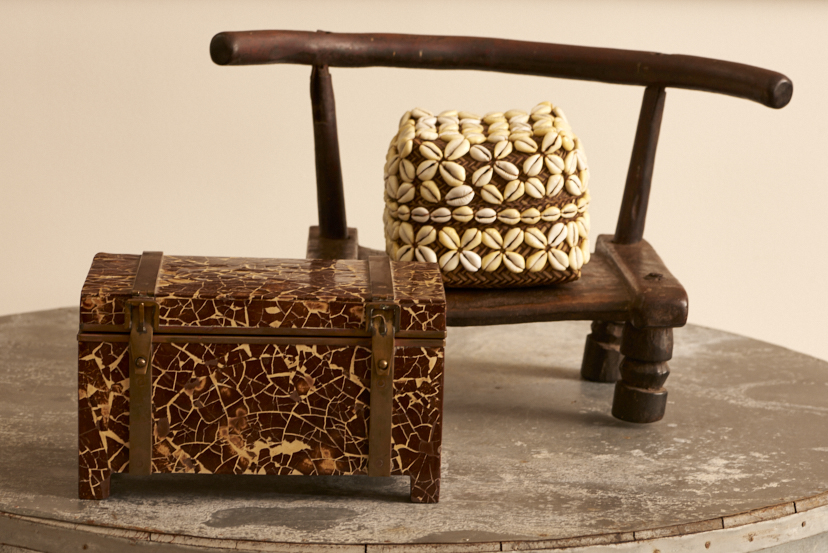 Primitive carved tribal child's chair, $450, African Cowrie shell box, $45, Nigeria, exotic wood chest, $1200