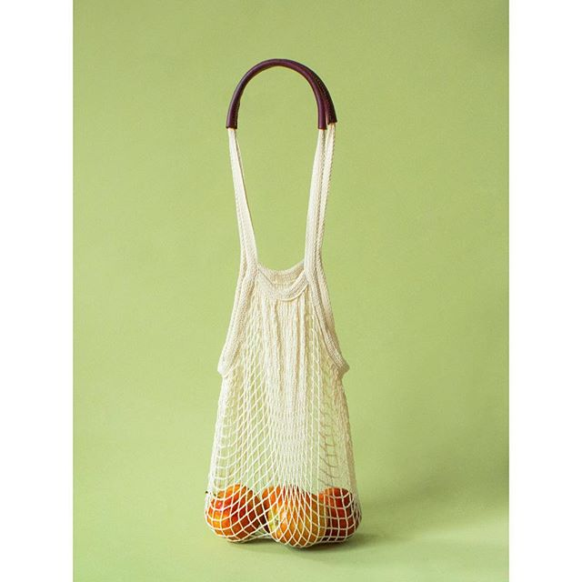 New! The Daisy Market Bag, here for all of your market needs.  A sweet + simple cotton mesh bag finished with durable vegetable tanned leather handles.  Big enough for your melons and small enough to fit in your pocket.  Make reusable bags cute again. . . Limited runs just listed on the website - check out the link in my bio 🍏 . . . #havethetemerity #market #temerityss2019 #leatherwork #farmersmarket #madeinla #madeinlosangeles