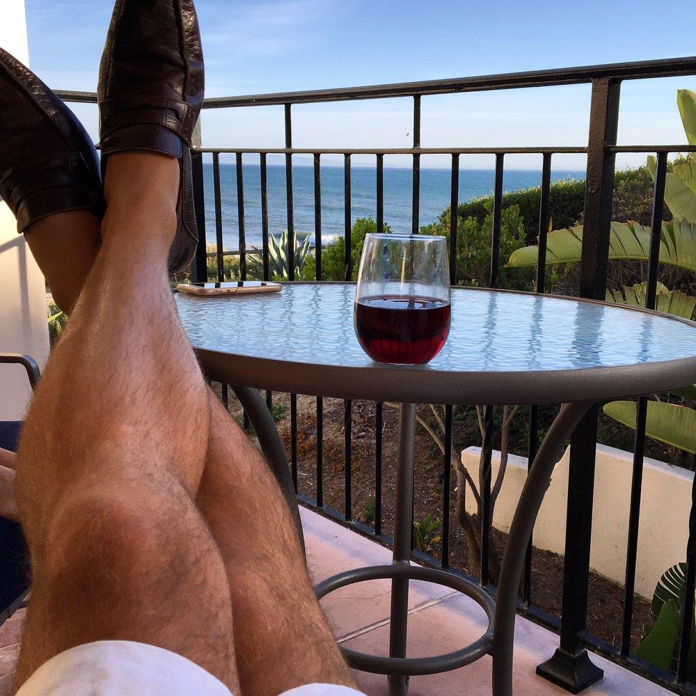 Enjoying the complimentary Pinot Noir.