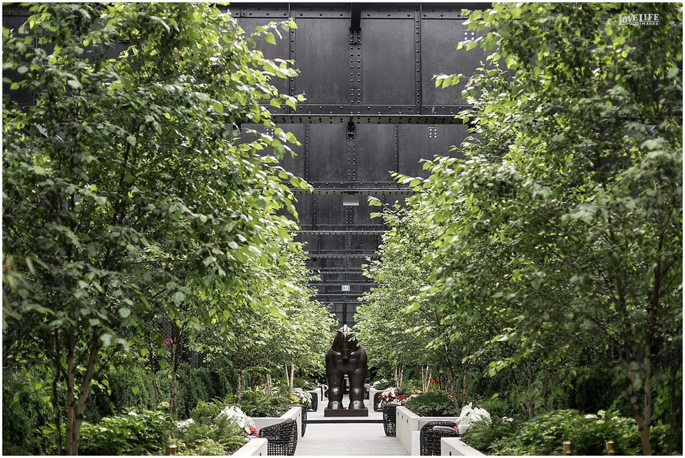 We are most excited about the courtyard, which is half covered with glass ceilings and has this amazing long aisle. The sculpture is a poignant fixture among the trees, and will be a stunning backdrop.
