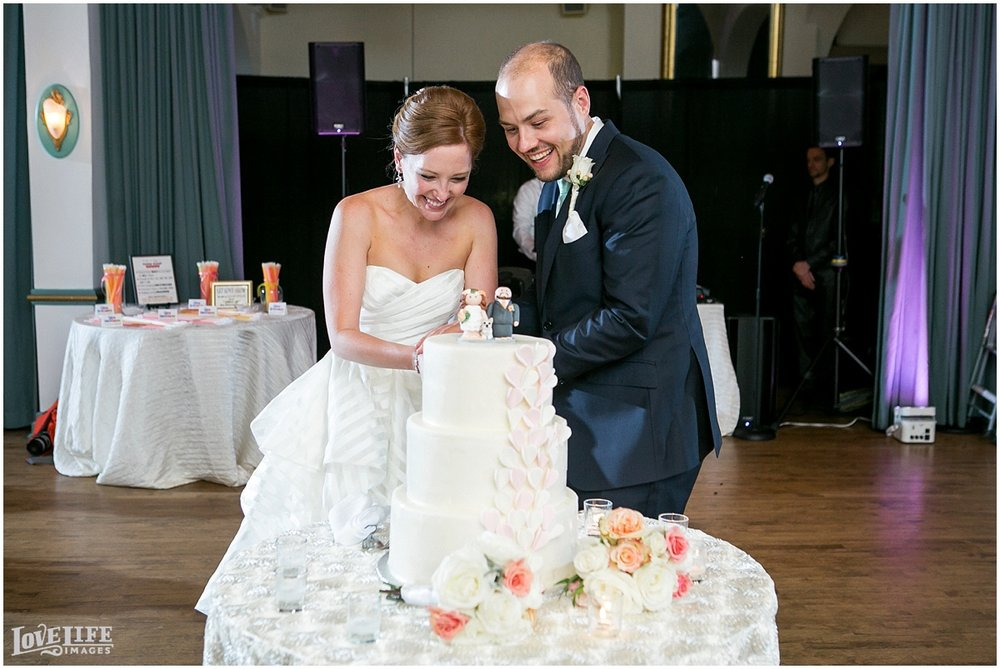 Clarendon Ballroom Wedding cake cutting.jpg