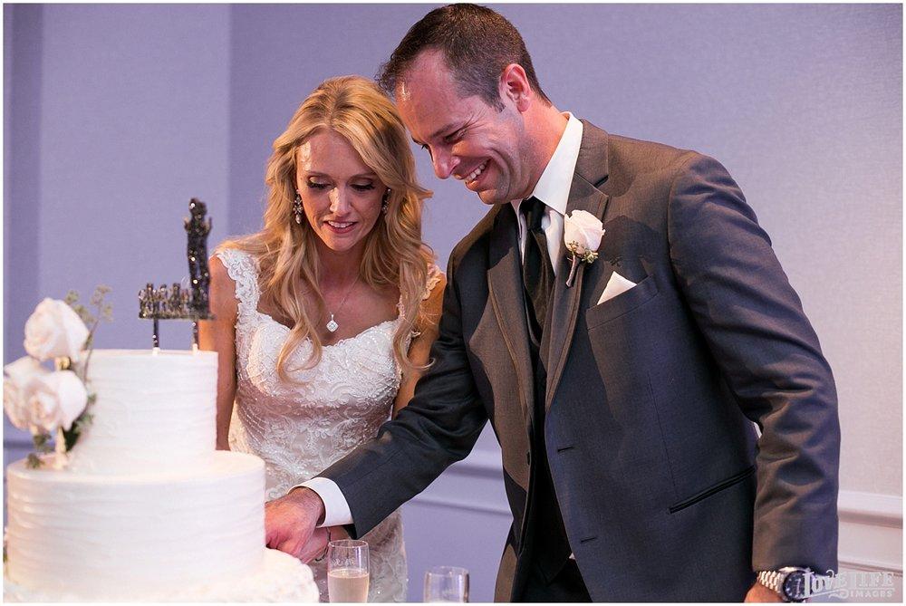 Mayflower Hotel DC Wedding cake cutting.jpg