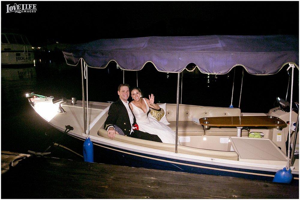 bride and groom on boat exiting wedding.JPG