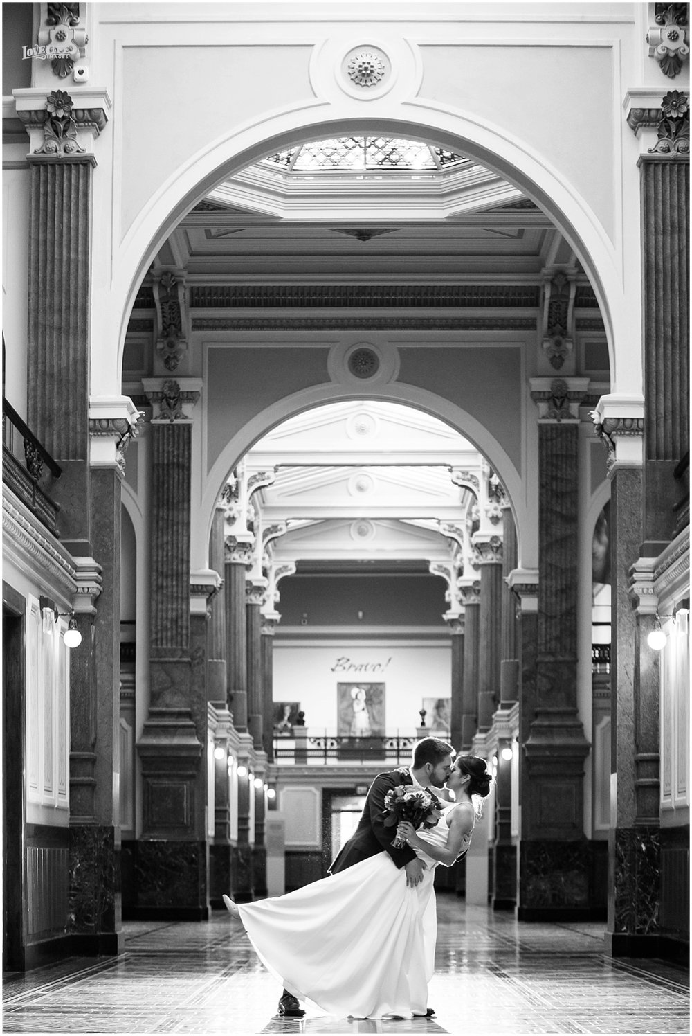 DC Hotel Monaco fall wedding couple kissing at portrait gallery.JPG