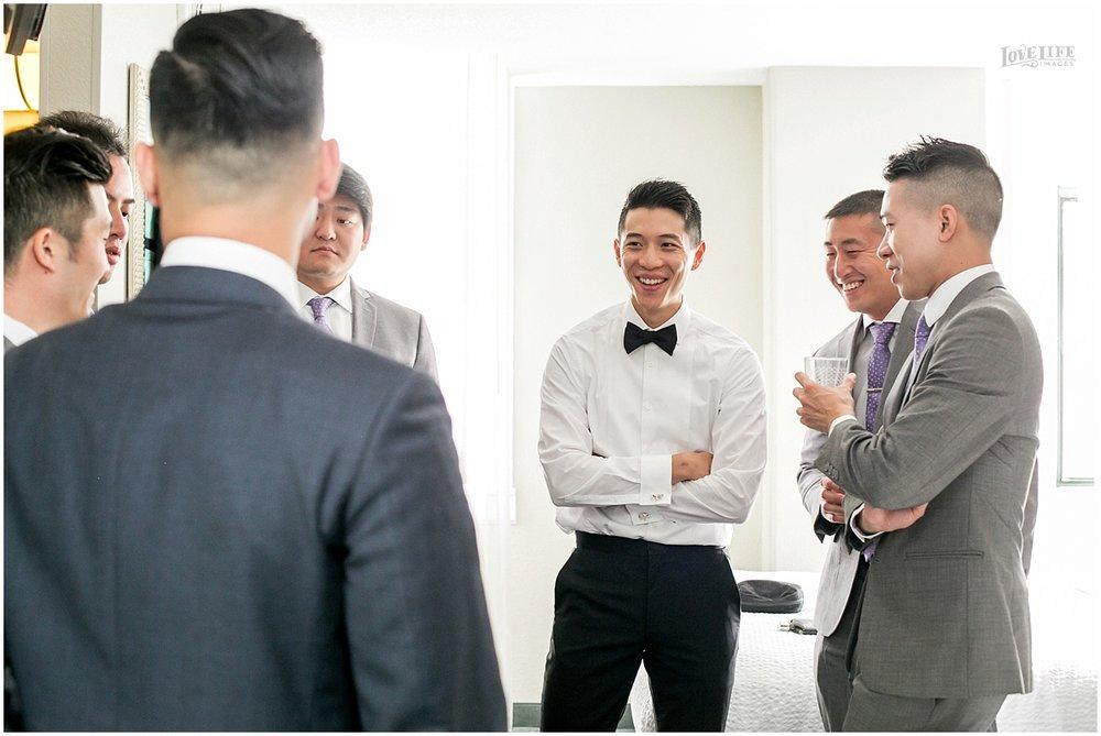 National Aquarium Baltimore Wedding groomsmen toasting.JPG