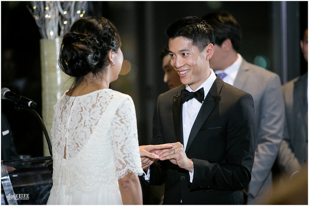 National Aquarium Baltimore Wedding bride and groom exchanging rings.JPG