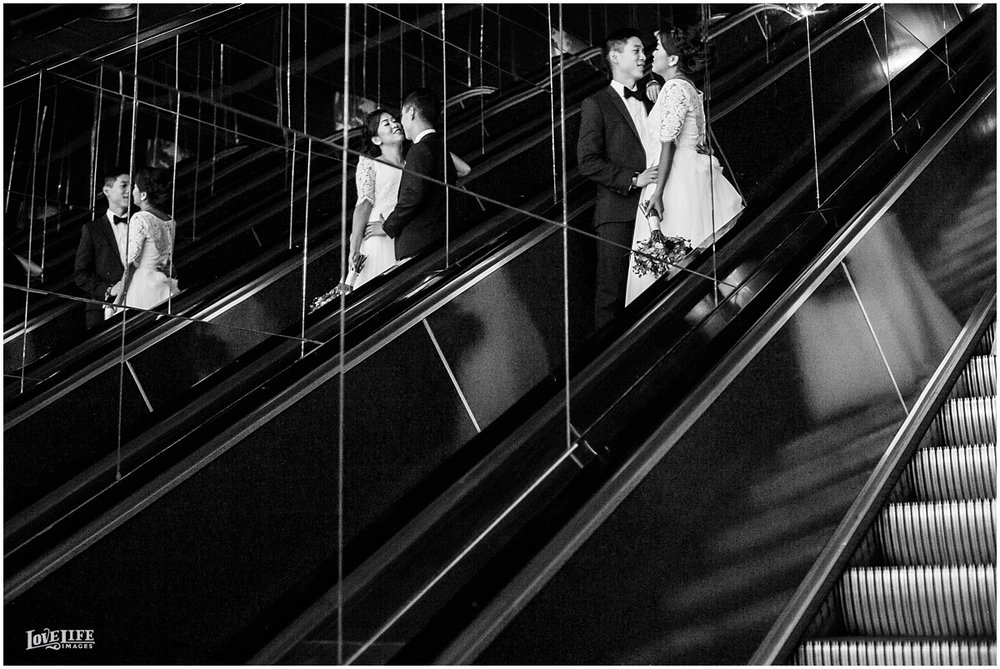 National Aquarium Baltimore Wedding couple portrait on escaltor.JPG