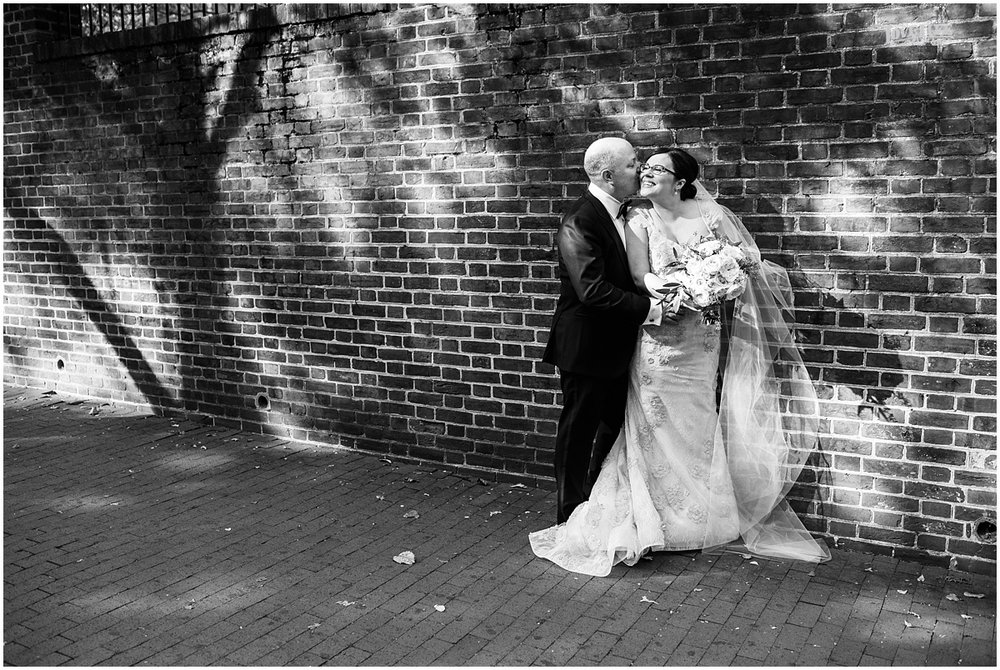 Dumbarton House wedding bride and groom portrait with brick background.JPG
