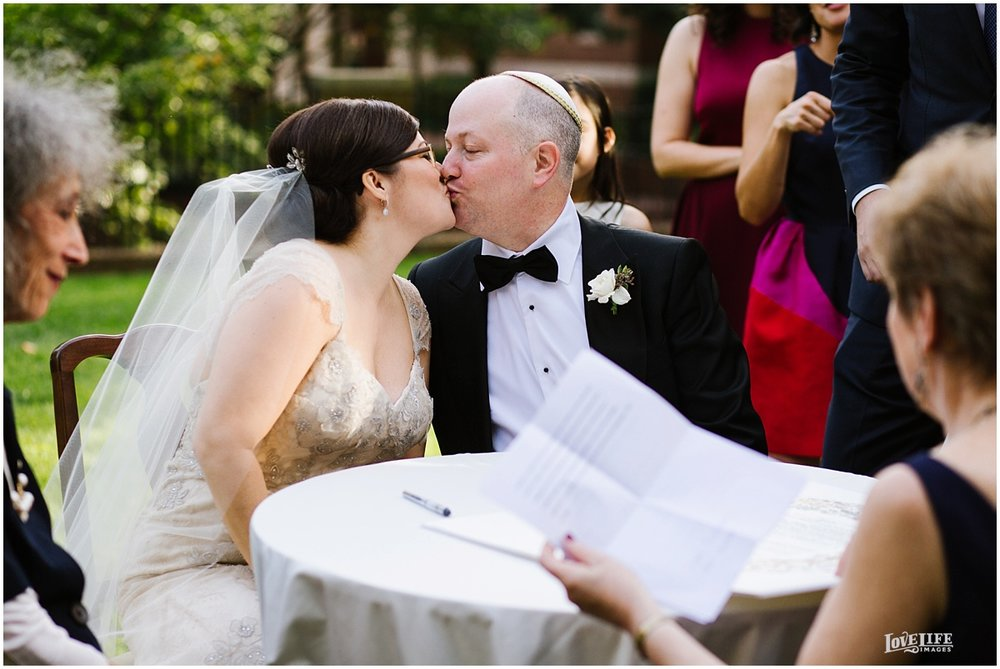 Dumbarton House wedding bride and groom kiss at ketubah signing.JPG