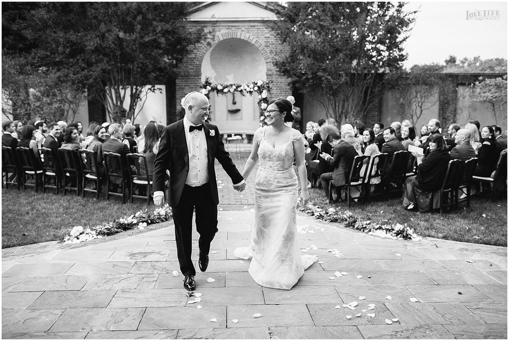 Dumbarton House wedding bride and groom recessional.JPG