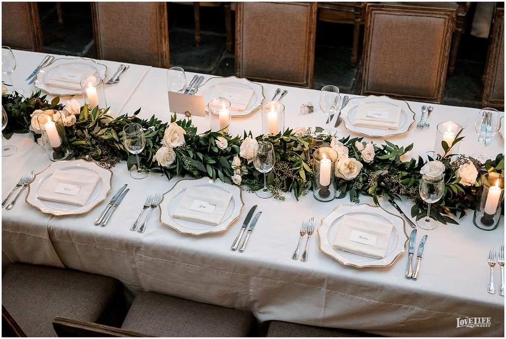 Dumbarton House wedding reception table decor with garland.jpg