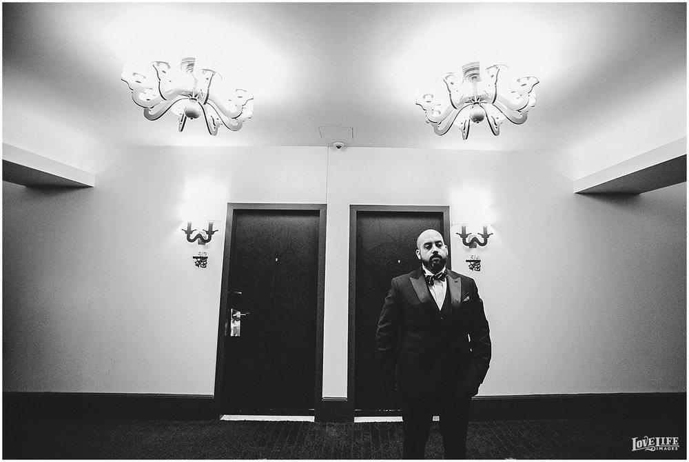 W Hotel DC wedding groom waiting for elevator.jpg