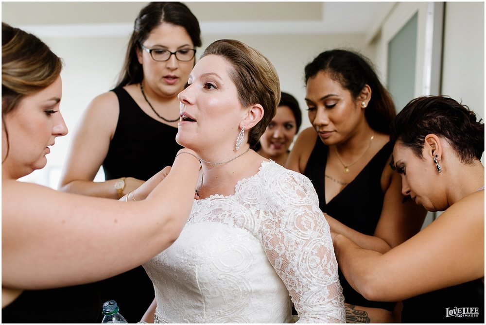 W Hotel DC wedding bride putting on dress.jpg