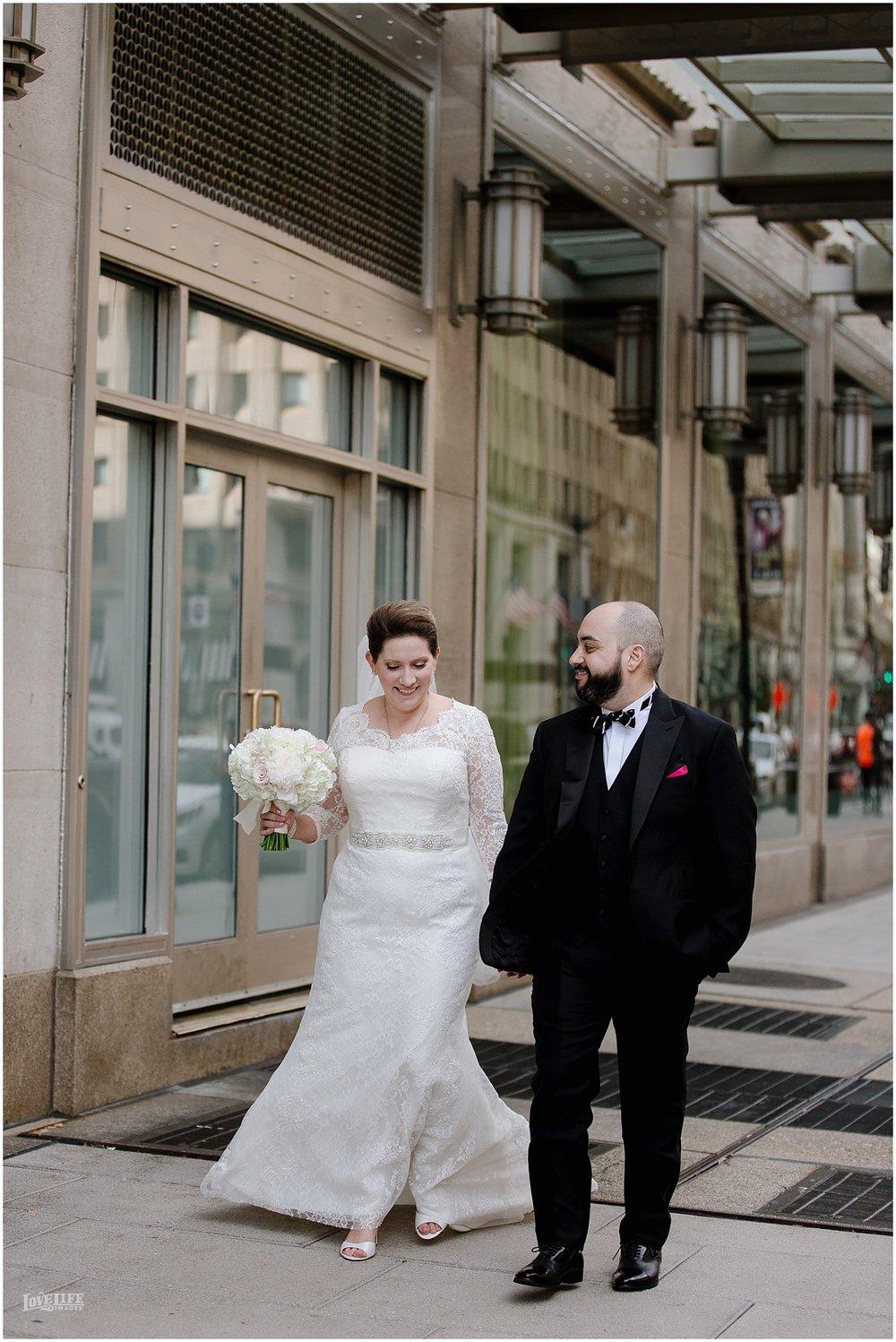 W Hotel DC wedding bride and groom walking portrait.jpg
