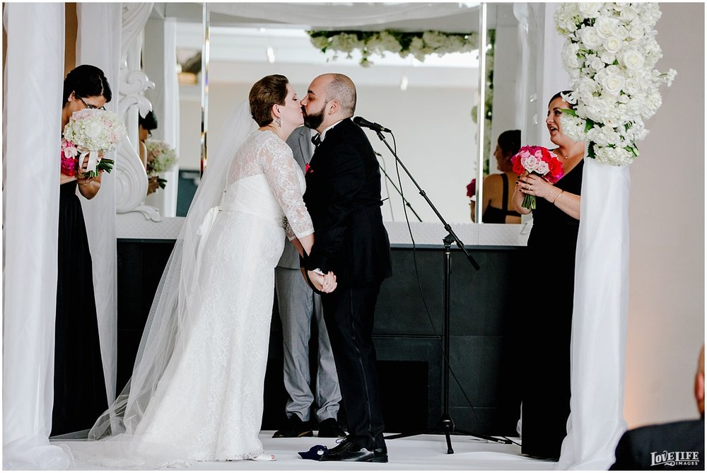 W Hotel DC wedding bride and groom kissing at altar.jpg