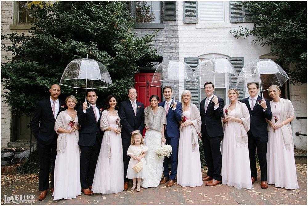 Pinstripes DC Wedding bridal party portrait with umbrellas.jpg