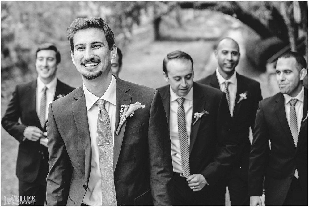 Pinstripes DC Wedding groomsmen laughing.jpg