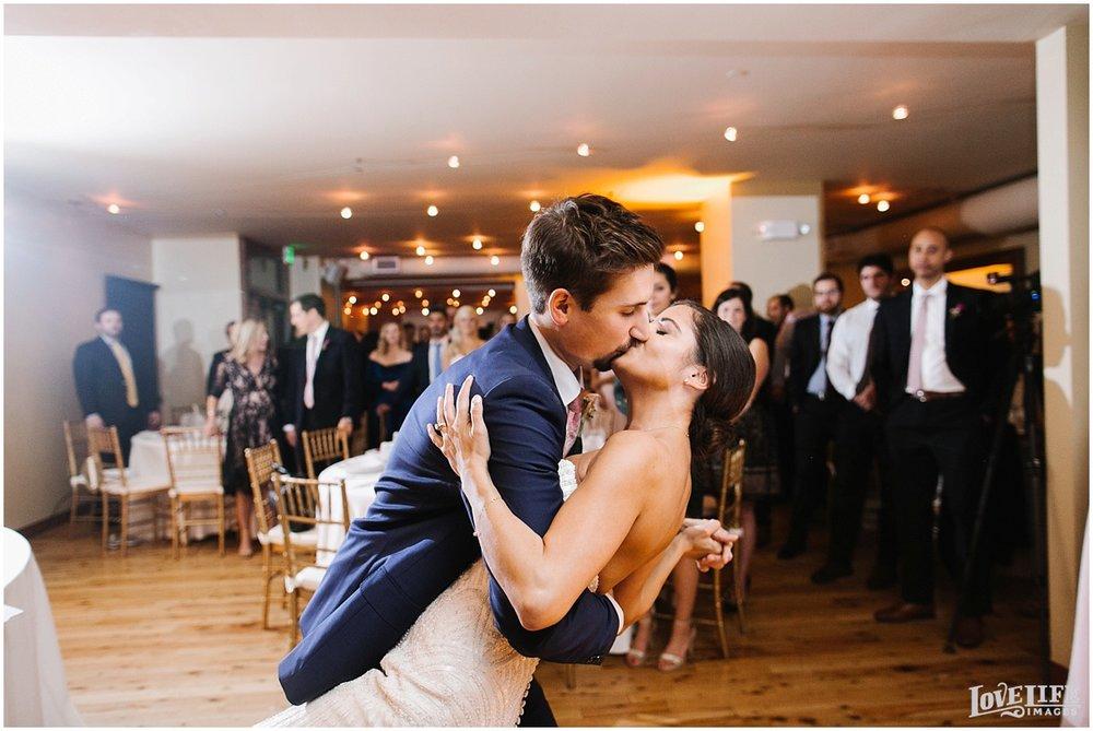 Pinstripes DC Wedding bride and groom kissing.jpg