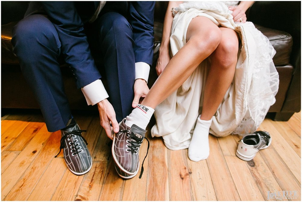 Pinstripes DC Wedding bride and groom in bowling shoes.jpg
