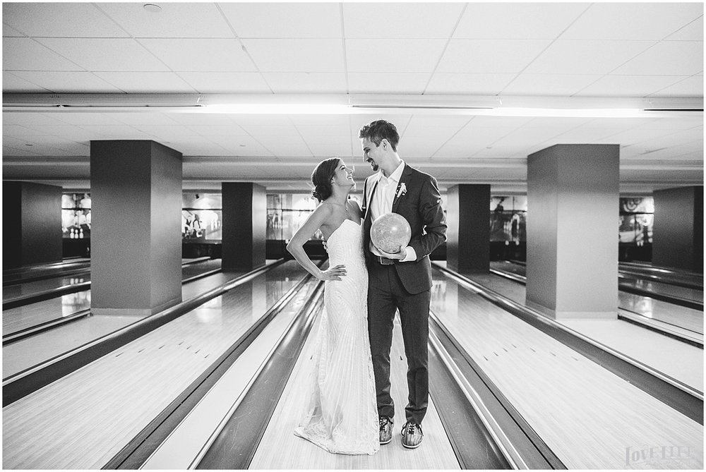 Pinstripes DC Wedding bride and groom in bowling alley.jpg