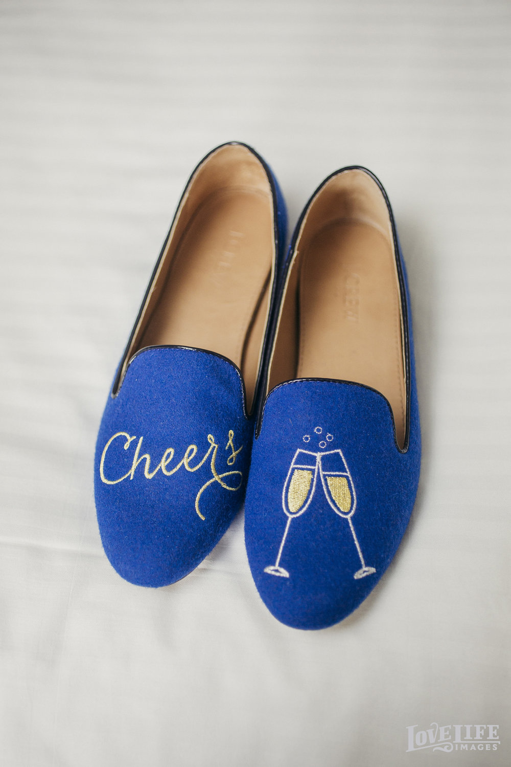 NYE Wedding_LoveLifeImages_blue slippers with champagne cheers.jpg