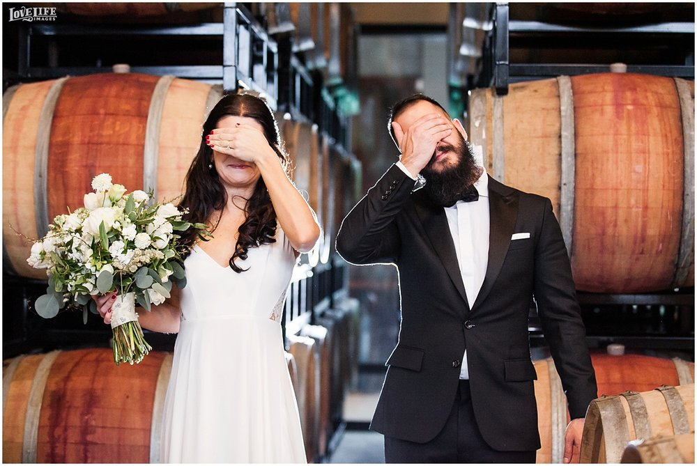 District Winery DC Wedding first look in wine barrels.jpg