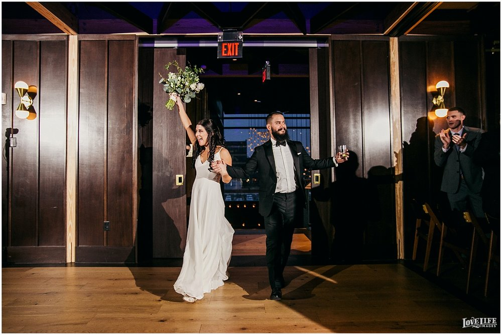 District Winery DC Wedding bride and groom announced to reception.jpg