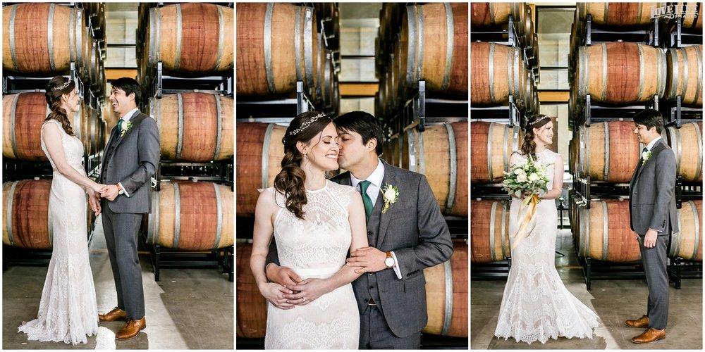 District Winery DC Wedding couple in wine barrels.jpg