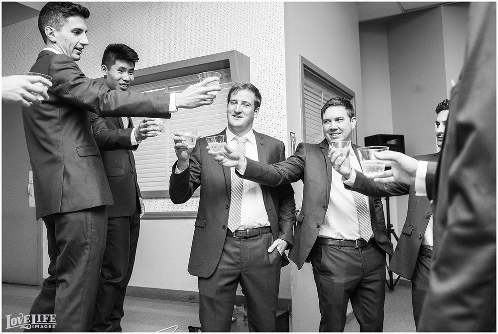 Baltimore Museum of Industry Wedding groomsmen toasting.jpg
