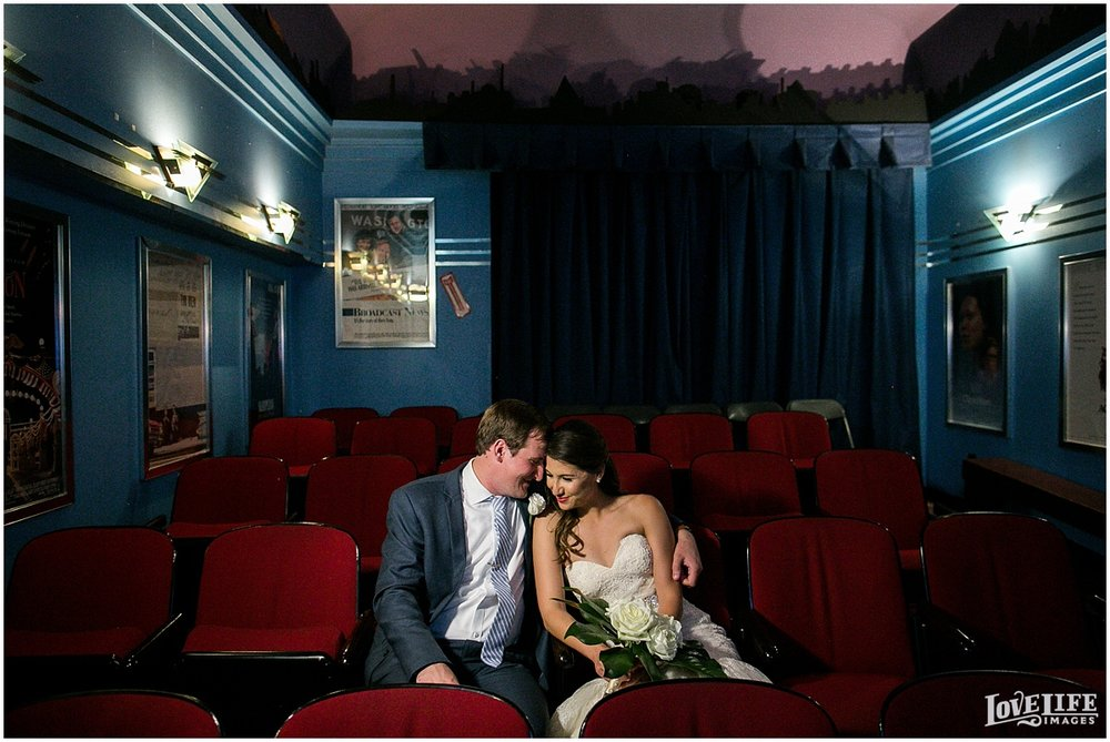Baltimore Museum of Industry Wedding bride groom in theater room.jpg