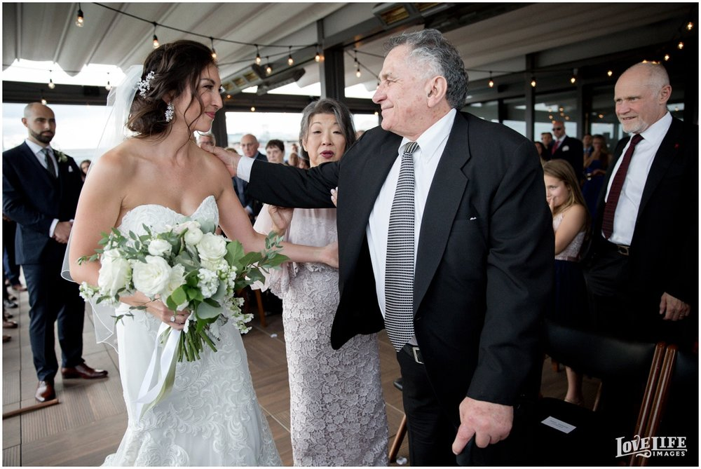 District Winery Fall DC wedding ceremony bride with parents.JPG
