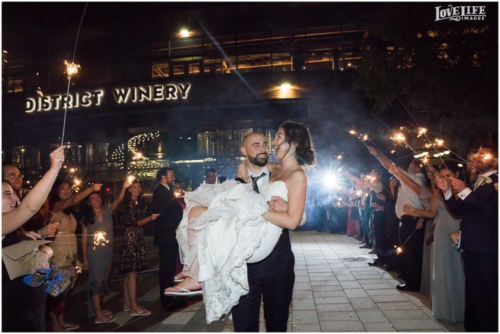 District Winery Fall DC wedding groom carrying bride sparkler exit.JPG