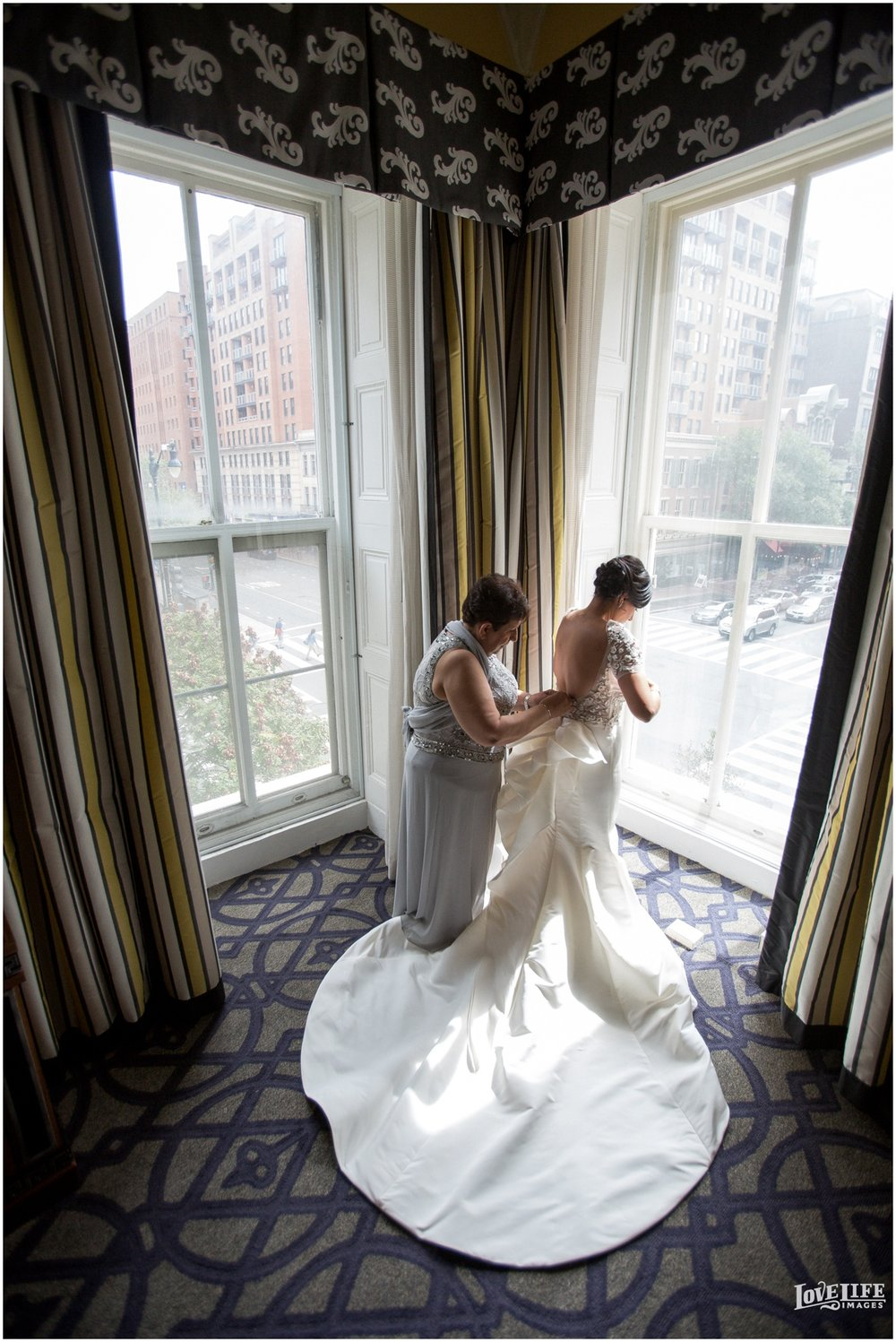 Hotel Monaco DC Wedding bride putting on gown.jpg