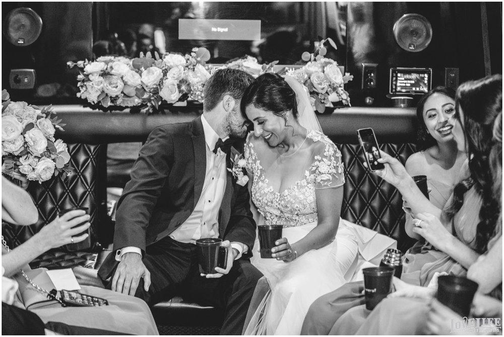Hotel Monaco DC Wedding bride groom in limo.jpg