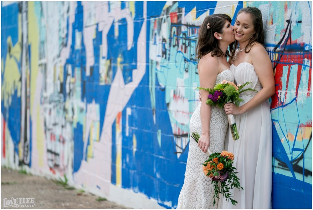 Same Sex Brewery DC Wedding brides portrait with mural.jpg